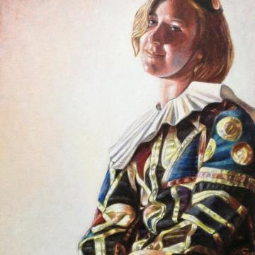 Eva in costume di Arlecchino